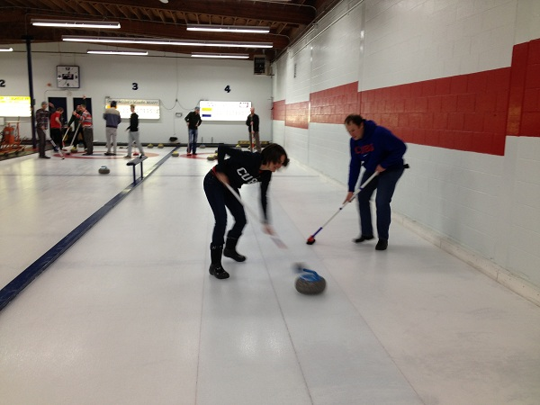 Curling in Fernie - Ankie is clearly better with a broom!