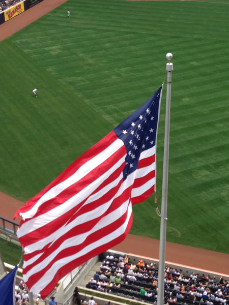 The giant US flag flying behind the bleachers at the new Yankee Stadium