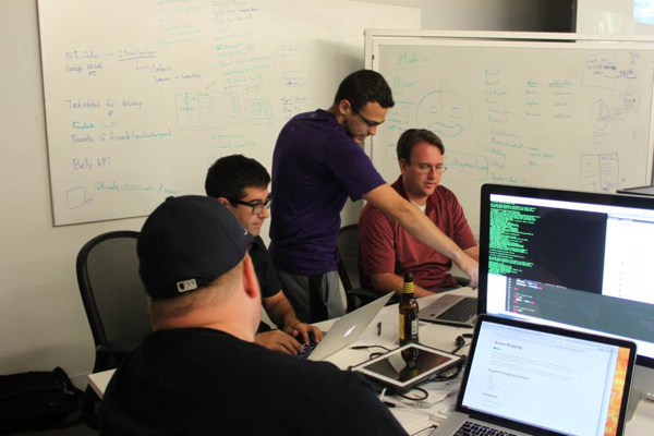 Picture of the iLostandFound team building the app